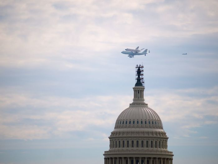 747 with Shuttle Discovery flyby over US Capitol Historic Space Travel Vehicle EyeEmNewHere 747 Capitol FlyBy Historical Monuments Space Shuttle Discovery Space Travel US Capitol Building Washington DC Washington, D. C. Architecture Building Exterior Dome Flying Government Historic Events Sky Cloud - Sky Architecture Government Travel Destinations Travel Built Structure No People Low Angle View The Architect - 2018 EyeEm Awards The Architect - 2018 EyeEm Awards