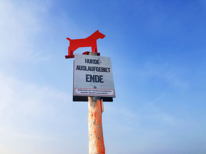 Beach Photography Beach Sign Beauty In Nature Dog Dog Sign Guidance Information Low Angle View Message Pole Red St Peter Ording Symbol Text