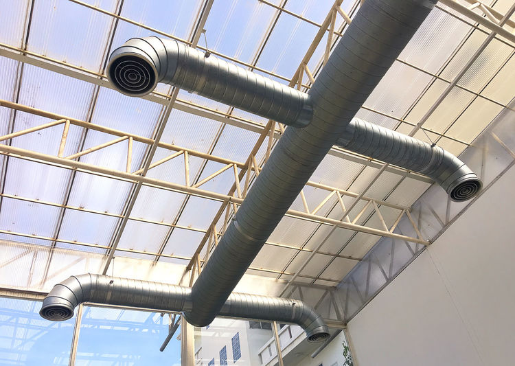 Air condition pipe Low Angle View Indoors  Metal Pipe - Tube Built Structure No People Architecture Day Ceiling Pattern Technology Industry Security Camera Pipeline Lighting Equipment Window Architectural Feature Close-up Fan Ornate Silver Colored