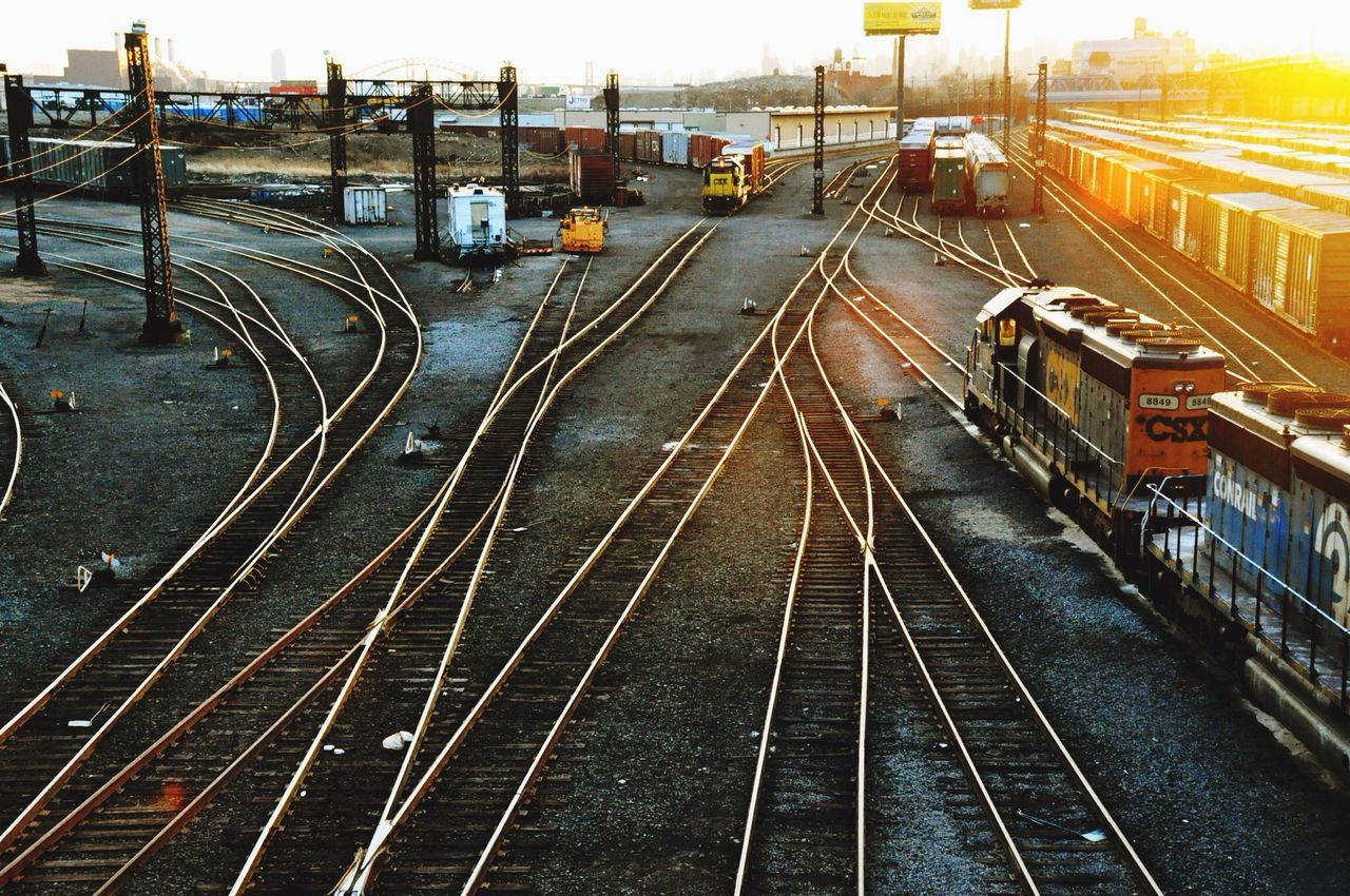 High angle view of trains on railroad tracks during sunset