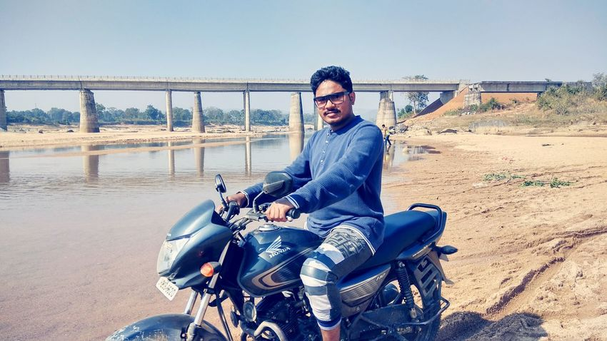 River EyeEm Selects Clear Sky Men Sitting Motorcycle Smiling Beach Happiness Biker Full Length Sand