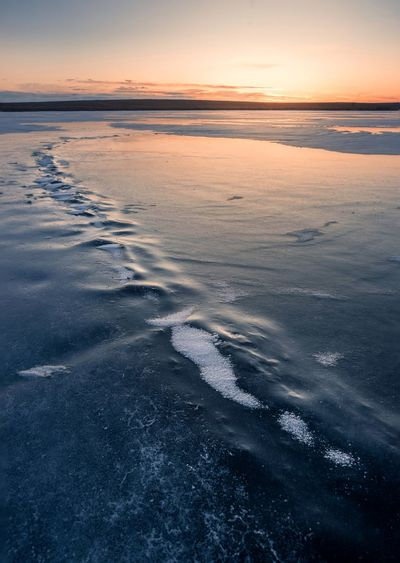 Ice Talks Reflections Leading Lines Ice Fishing Fishing South Dakota Lake Ice Beauty In Nature Sunset Nature Scenics Tranquil Scene Tranquility Water Outdoors No People Beach Sky Horizon Over Water Wave Day