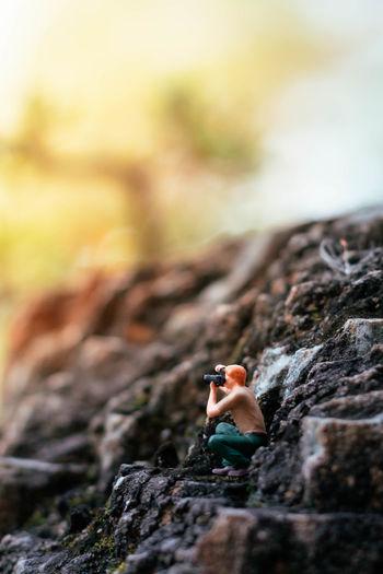 Close-up of man climbing on rock