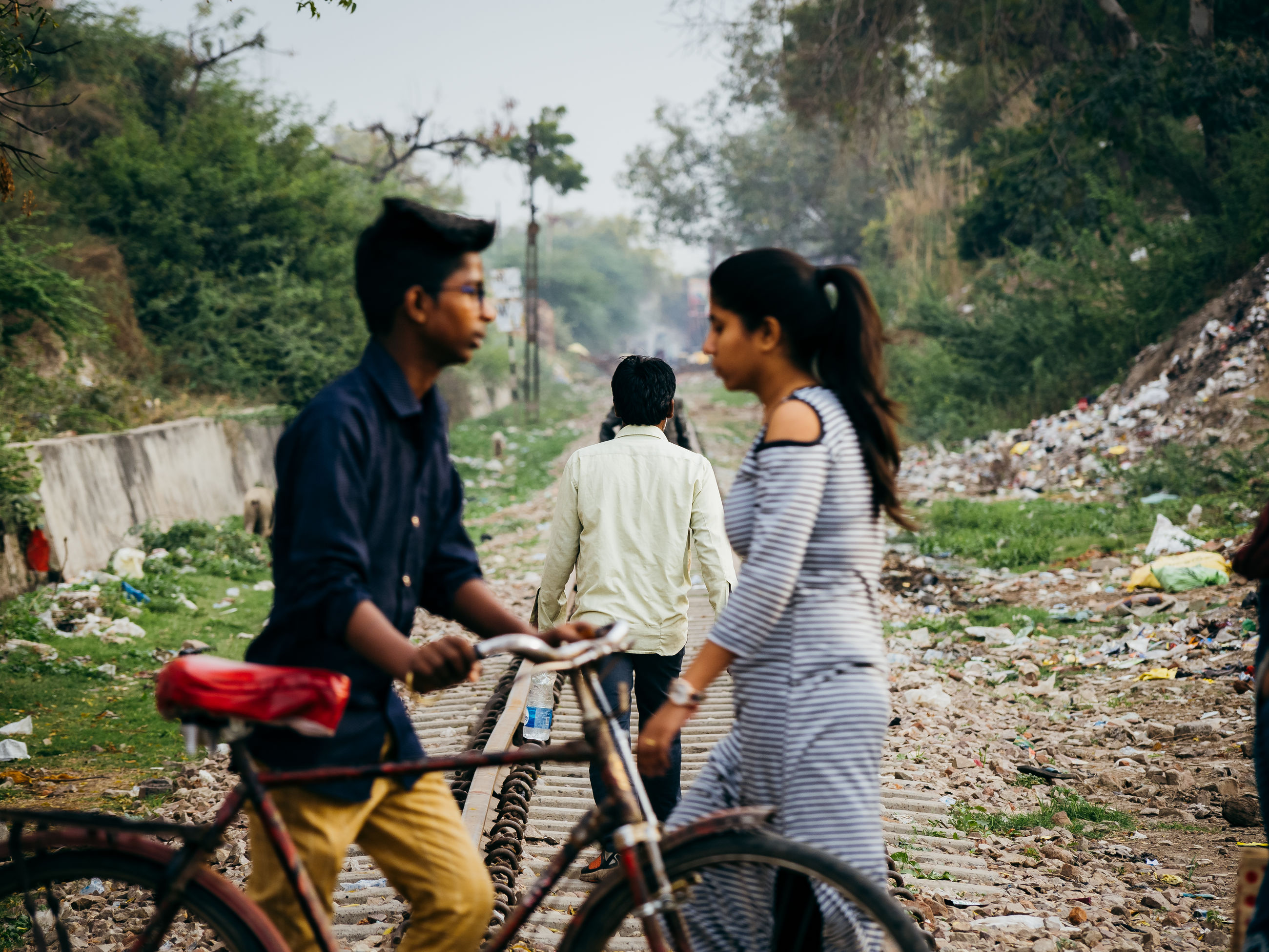 lifestyles, togetherness, real people, bicycle, men, casual clothing, transportation, bonding, adult, leisure activity, three quarter length, nature, two people, people, plant, women, land vehicle, tree, day, rear view, outdoors, positive emotion, riding, couple - relationship