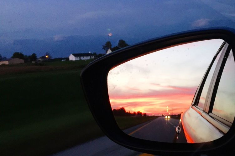 Behind Me Car Land Vehicle Mode Of Transport Transportation Sunset Side-view Mirror Travel Part Of Reflection Close-up Sky Window Glass - Material Cloud - Sky Orange Color Focus On Foreground Journey Outdoors Flying EyeEm Best Shots Eye4photography  EyeEm Gallery EyeEm Exceptional Photographs