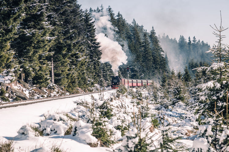 Steam Train On Railroad Tracks During Winter