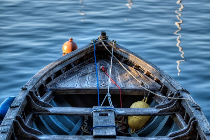 Small wooden boat at the port. Water Nautical Vessel Rope Nature Transportation Mode Of Transportation Sea No People Day Buoy Outdoors High Angle View Tied Up Wood - Material Boat Boats Boats⛵️ Boats And Water Port Fishing Boat Wooden Blue Tranquility Tranquil Scene Wave
