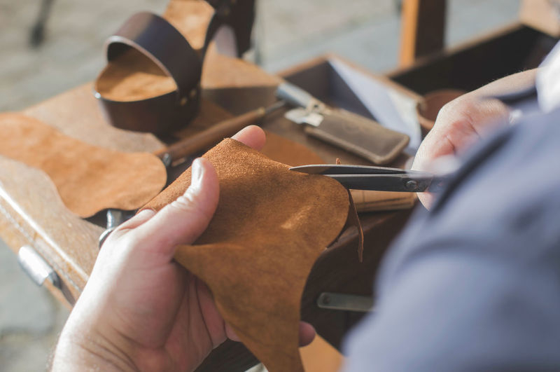 Shoes Shoemaker Craft Leather Hands Handmade Work Tools Human Hand Hand Real People Men Human Body Part Selective Focus Working Occupation Holding One Person Wood - Material Table Close-up Indoors  Adult Skill  Day Workshop Finger
