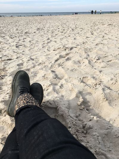 Autumn Boots Day At The Beach Beach Body Part Day Human Body Part Human Leg Jeans Lifestyles Nature Outdoors Personal Perspective Real People Relaxation Sand Sea Sky Unrecognizable Person