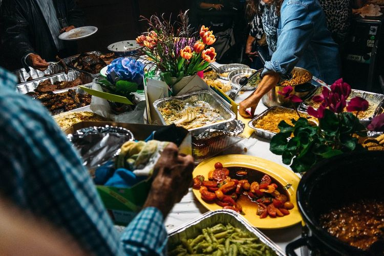 Birthday Choice Community Customer  Dinner Food Food And Drink Freshness Hot Dish Human Body Part Human Hand Market Market Stall Night Outdoors Party People Picnic Potluck Real People Retail  Sharing  Small Town Variety