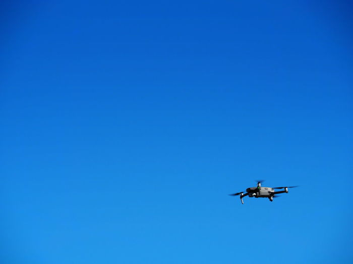 Blue Flying Air Vehicle Sky Copy Space Transportation Mode Of Transportation Clear Sky Low Angle View Mid-air Airplane No People Motion Nature on the move Day Military Travel Outdoors Plane Aerospace Industry Drone