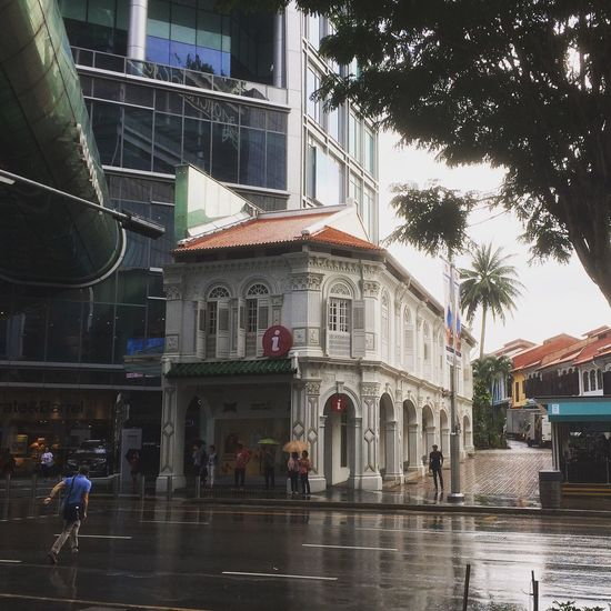 Singapore is full of old and new Singapore Building love the guy running though the rain in the photo