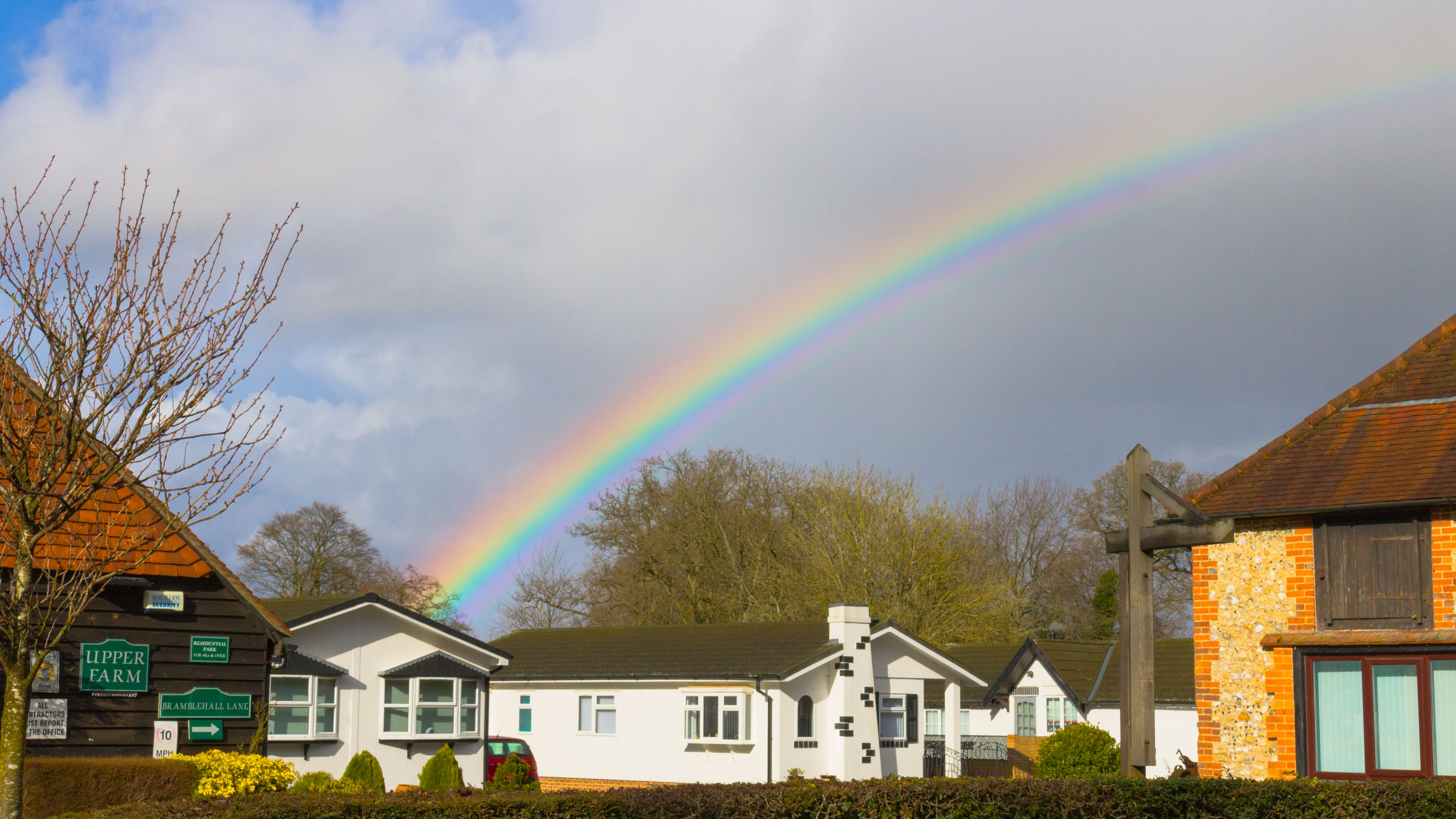 rainbow, building exterior, multi colored, sky, built structure, double rainbow, tree, architecture, outdoors, idyllic, cloud - sky, house, beauty in nature, bare tree, no people, day, nature