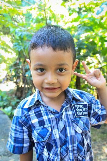 Portrait of smiling boy gesturing