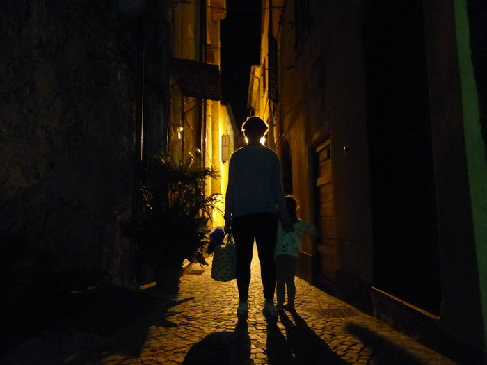 Borgomaro Light Alley Alleyway Built Structure Lifestyles Light And Shadow Night Outdoors People Real People Rear View Street Streetphotography Two People Vicoli Vicolo Walking