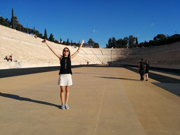 Panathenaicstadium Winner Traveling Hands In The Air Smile Stadium Sunny Day