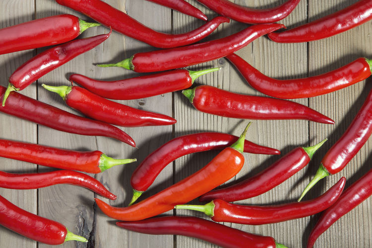 High Angle View Of Red Chilies On Table