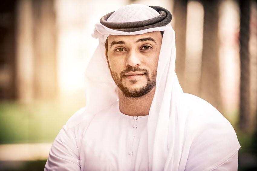 Arabic man portrait Arabian Business Dubai Isolated Man Middle Eastern UAE Arabic Background Beard Businessman Emirates Face Gulf Handsome Headshot Islamic Kandora Kandura Male Midde East Muslim Portrait Scarf Studio Shot