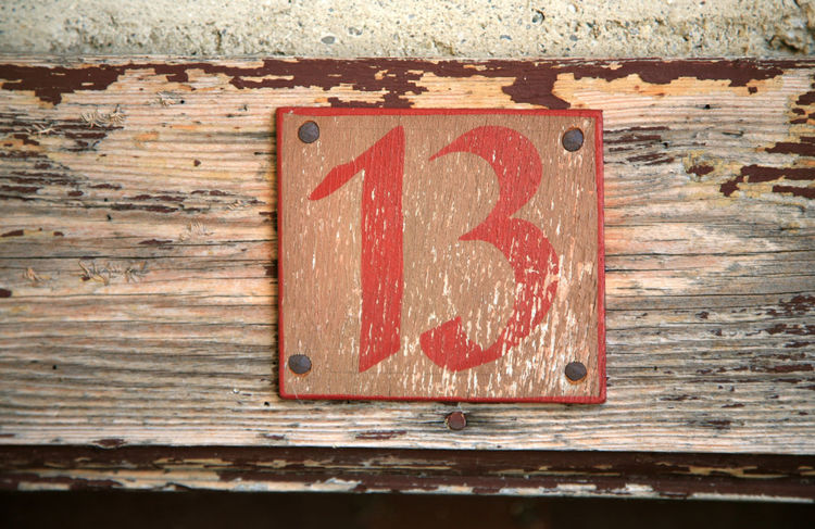 Old wooden door sign with number 13 13 Door Sign Sign Thirteen Weathered Architecture Close-up Grunge No People Number Old Outdoors Plank Red Wood - Material Wooden