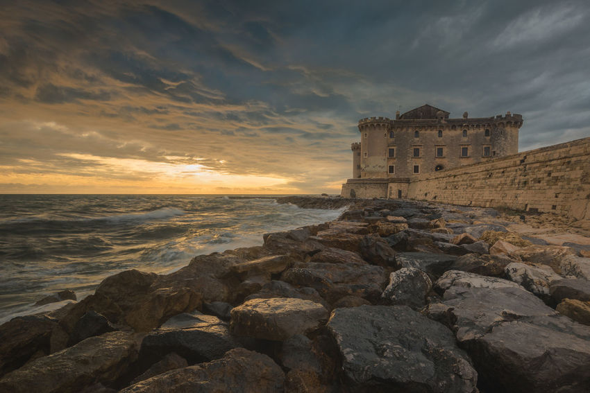 Sunset at the castle of Palo Laziale EyeEm Best Shots EyeEm Nature Lover EyeEm Selects EyeEm Gallery EyeEmNewHere Nikon Tranquility Architecture Beach Beauty In Nature Building Exterior Built Structure Cloud - Sky Horizon Over Water Nature No People Outdoors Rock - Object Scenics Sea Sky Sunset Tranquil Scene Travel Destinations Water The Great Outdoors - 2018 EyeEm Awards