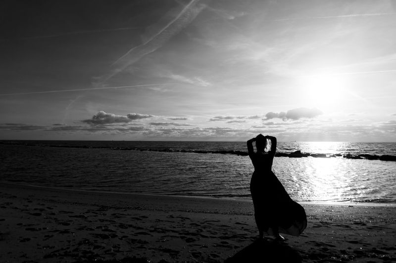 Adult Beach Beauty In Nature Day Horizon Over Water Lifestyles Nature One Person One Woman Only Outdoors People Photography Themes Real People Rear View Sand Scenics Sea Silhouette Sky Technology Water Women Young Adult EyeEmNewHere TCPM