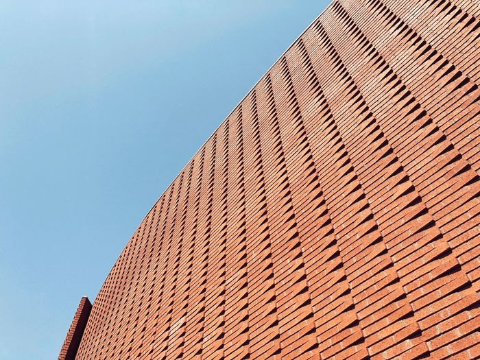 Architecture Low Angle View Built Structure Sky Clear Sky No People Building Exterior Pattern Building Day Blue Brick Sunny Wall - Building Feature
