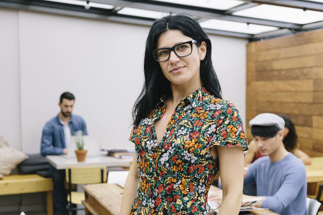 Businesswoman Casual Clothing Caucasian Cheerful Colleagues Confident  Corporate Coworking European  Eyeglasses  Front View Glasses Indoors  Multiethnic Group Portrait Professional Real People Startup Teamwork Technology Waist Up Women Working