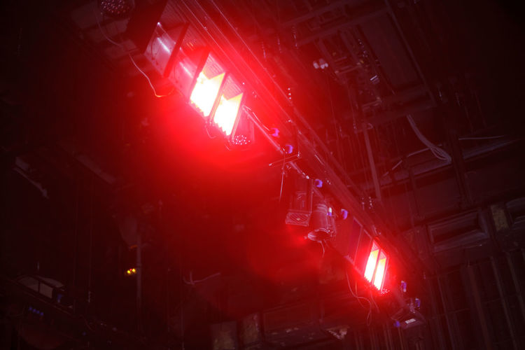 many theater flood lights Illuminated Red Night Architecture Building Exterior Lighting Equipment Nightlife Flare Beam Party Background Abstract Spot Light  Glowing Performance Decoration Floodlight Show Theater Entertainment Ray Effects Equipment Studio Ceiling