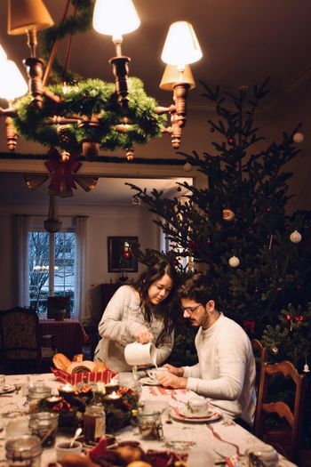 Our first Christmas together after 2 years. Real People Brunch Mornings Breakfast Good Morning Partner Christmas Holidays Love Relationship Couple Company Christmas christmas tree Tree Celebration Christmas Decoration Table Togetherness Sitting Illuminated Lifestyles Happiness This Is Family The Portraitist - 2018 EyeEm Awards