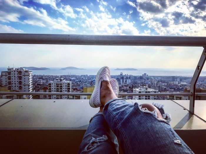 Low Section Sky Human Leg One Person Cloud - Sky Built Structure Human Body Part Architecture Body Part Personal Perspective Building Exterior Legs Crossed At Ankle Lifestyles Nature Real People Cityscape Shoe Day City Relaxation