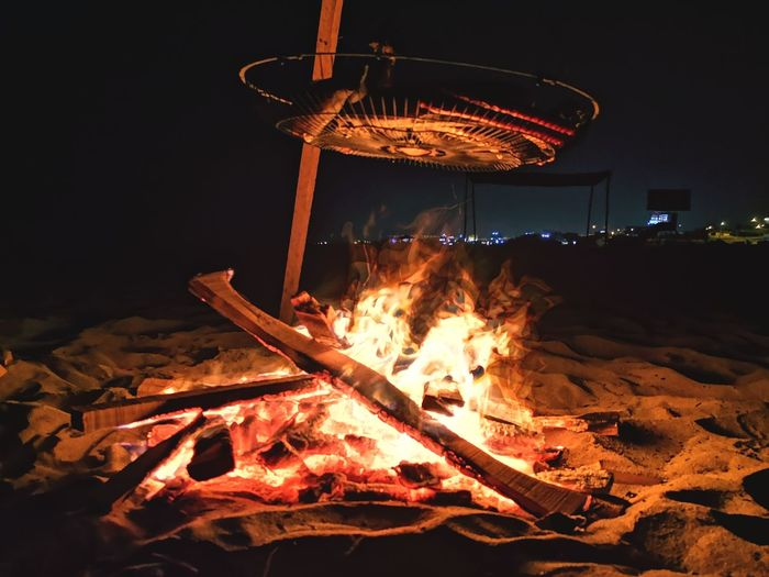 Bonfire by fire at night