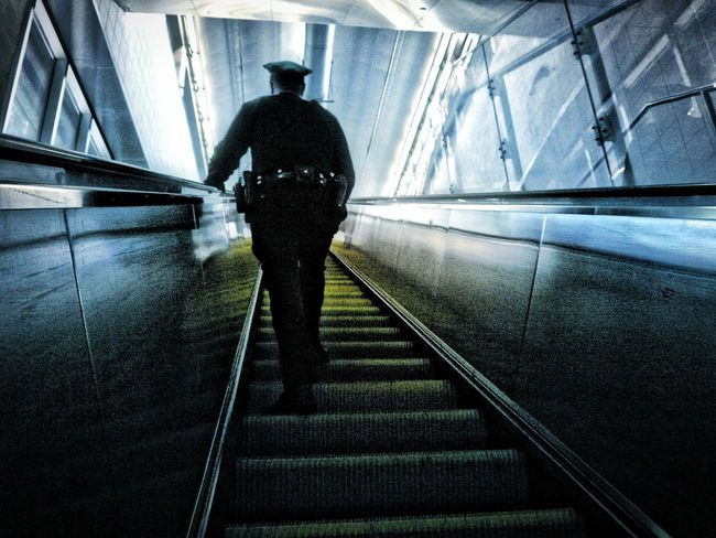 Cop controls Trainstation Train Station Escalator Officer Cops Under Control Portrait Of America Security On Guard On Duty Call 911