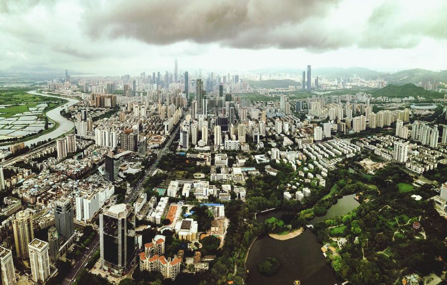 Rapidly Growing StRegisShenzhen China Shenzhen Building Exterior Architecture City Built Structure Cloud - Sky Sky Cityscape Building Crowd Crowded Day Office Building Exterior High Angle View
