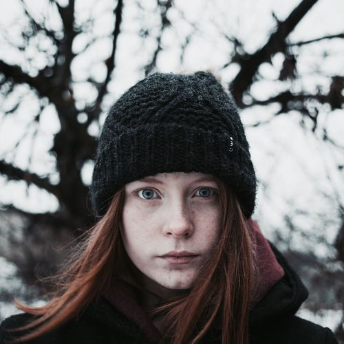Close-Up Portrait Of Teenage Girl In Snow