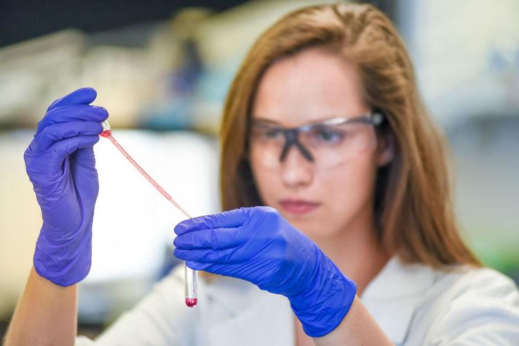 Scientist performing scientific experiment