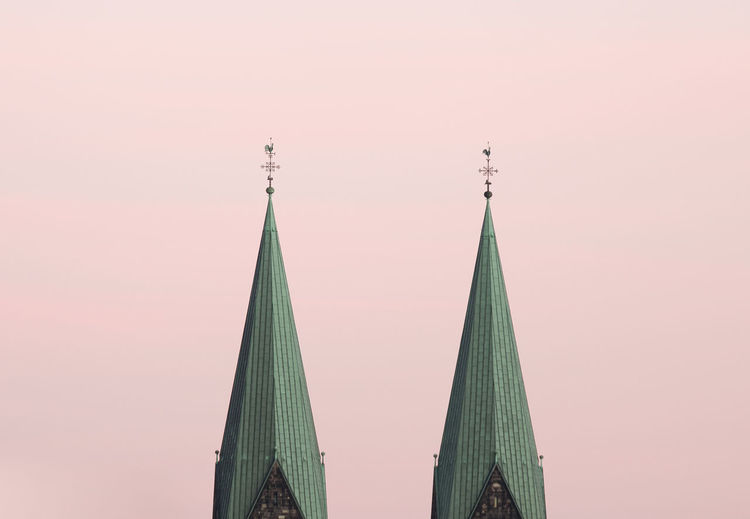 Low Angle View Of Steeples Against Sky
