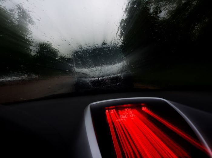 Close-up of road seen through car window