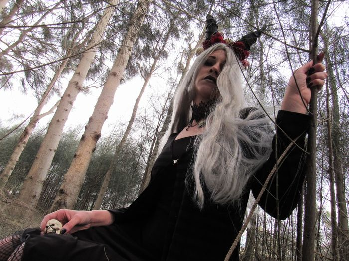 Angela Caven Adult Adults Only Blond Hair Day Forest Gothic Style Human Body Part Leisure Activity Low Angle View Nature One Person Only Women Outdoors People Sky Smiling Tree Young Adult