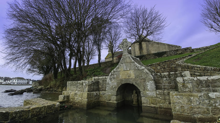 Fountain Architecture Bare Tree Bridge - Man Made Structure Building Exterior Built Structure Castle Day History Nature No People Outdoors Saint Cado Morbihan France Sky Tree Water