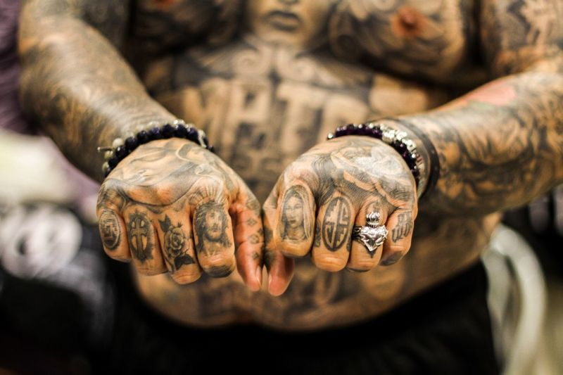Cropped image of man with tattoo