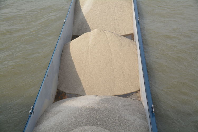 High angle view of sand in boat