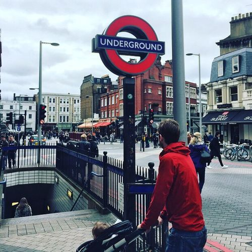 Architecture Building Exterior Built Structure Pushchair Red Hoodie Red Incidental People Real People Day Text Land Vehicle Car Mode Of Transport Communication Street Travel Destinations Road Sign Outdoors Cloud - Sky Sky London Underground London Underground Metro Subway