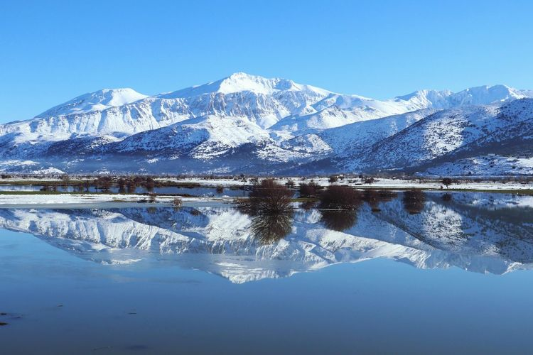 Reflecting Mountains Crete Greece Lassithi Plateau Lasithi Mirror Reflections In The Water Reflection Lake Snowy Beautiful Landscape Hill Hills Blue Crete Cold Cold Temperature Ice Mountain Range Mountain Top Water Lake Reflect Reflections In The Water Reflecting Pool Reflection Perfection  Still Water Surface Kreta Frost Frozen Lake