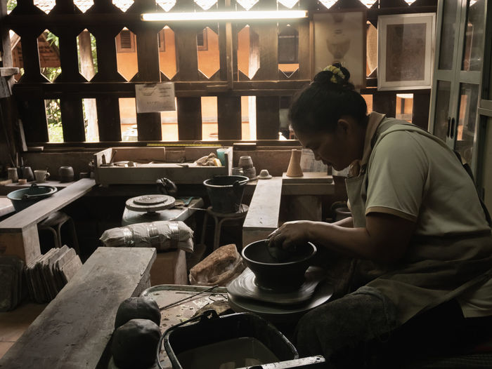 14 July 2017, potters working in the earthenware industrial, Chiang rai Thailand Art Bowl Brown Ceramic Clay Craft Cup Dirty Earthenware Finger Hand Handicraft Handmade Industrial Industrial Background Making Manufacturing Master Pot Potter Pottery Shape Skill  Traditional Wet Wheel Work Workshop