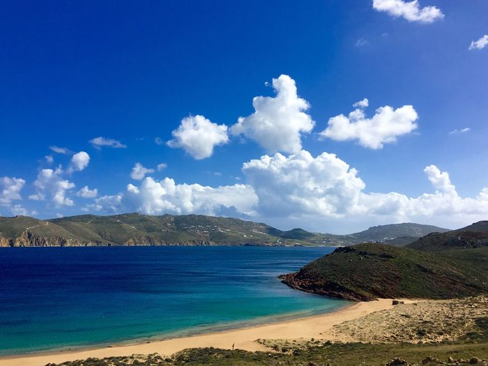 Scenic View Of Mykonos Island Against Cloudy Sky