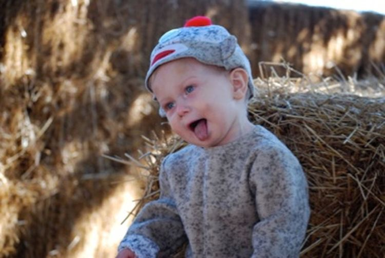 Portrait of cute baby girl in grass