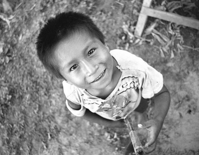 Amazon Anthropology Boy Childhood Close-up Day Drug Ecuador Front View High Angle View Human Body Part Looking At Camera Mud One Person Outdoors People Portrait Real People Remote Shamanism Tribe