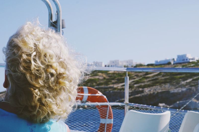On the ferry Curly Hair One Person Day Outdoors Real People Rear View Childhood Water Blond Hair Clear Sky Sky Architecture Close-up People Ferry Travel Traveling Tourist Vacations Holiday Summer Greece Greek Islands This Is Aging