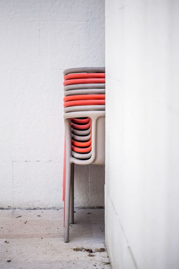 Chairs stacked against wall