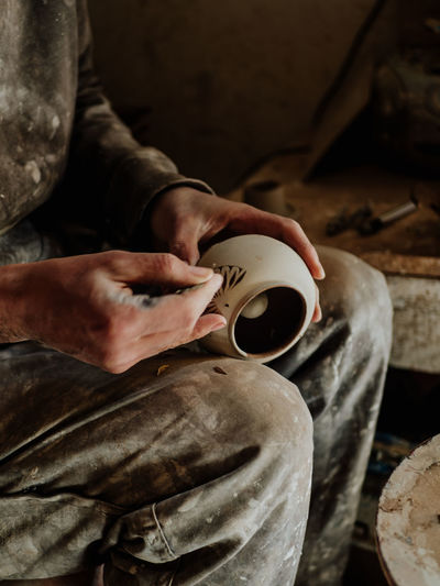 Midsection of potter working at work shop